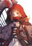 1girl arm_up bag bangs belt belt_buckle blonde_hair blunt_bangs blush bow brown_belt buckle cape chain closed_mouth dress fire hood hood_up hooded_cape little_red_riding_hood_(sinoalice) long_hair long_sleeves looking_at_viewer nozomiaisha red_bow red_cape red_hood simple_background sinoalice smile solo standing weapon white_background yellow_eyes