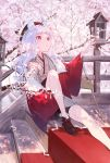1girl animal_ears commentary_request day ema hat highres hotosoka_(user_nxja5583) japanese_clothes knee_up long_hair mouse_ears original outdoors outstretched_hand red_eyes shoes sitting solo stairs tagme white_hair