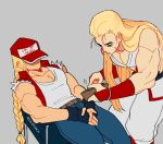 2boys andy_bogard armband artist_name blonde_hair braided_ponytail covered_eyes denim fatal_fury fatal_fury_cap fingerless_gloves gloves jacket jeans long_hair multiple_boys pants regiusfurca sleeveless terry_bogard theft