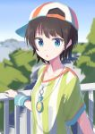 1girl bangs black_hair blue_eyes chestnut_mouth commentary day hat highres hololive looking_at_viewer oozora_subaru outdoors railing senda_nara shirt short_hair sideways_hat striped striped_shirt t-shirt vertical-striped_shirt vertical_stripes virtual_youtuber whistle whistle_around_neck wristband