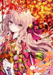 1girl animal_ear_fluff animal_ears autumn_leaves bell blurry blurry_foreground blush bow breasts brown_hair cat_ears closed_mouth commentary_request depth_of_field floral_print flower hair_bell hair_bow hair_ornament japanese_clothes jingle_bell kimono leaf long_sleeves looking_at_viewer maple_leaf medium_breasts nanase_kureha nanase_nao original pink_flower print_kimono purple_bow red_flower red_kimono sleeves_past_wrists solo white_flower wide_sleeves yellow_eyes