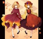 2girls aki_minoriko aki_shizuha apron asa_no_ha_(pattern) autumn_leaves black_choker black_footwear blonde_hair choker full_body hair_ornament kyouda_suzuka leaf leaf_hair_ornament long_sleeves maple_leaf multiple_girls seigaiha shoes short_hair skirt smile socks touhou wide_sleeves yellow_eyes