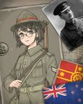 1boy 1girl absurdres belt blue_eyes blush breast_pocket brown_hair brown_headwear brown_shirt collared_shirt eyebrows_visible_through_hair glasses gun hat highres long_sleeves looking_at_viewer military new_zealand_flag original parted_lips photo_(object) pocket pzkpfwi rifle_on_back round_eyewear shirt short_hair weapon