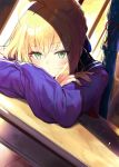 1girl ahoge arm_rest artoria_pendragon_(all) blonde_hair blush braid capsule_servant classroom closed_mouth commentary crossed_arms crown_braid desk dusk eyebrows_visible_through_hair fate/hollow_ataraxia fate_(series) green_eyes hair_between_eyes indoors long_sleeves looking_at_viewer master_artoria miruto_netsuki red_neckwear sailor_collar school_uniform serafuku shade short_hair sitting solo sunlight weapon_bag