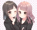 2girls ;) bangs black_hair black_hoodie blush brown_eyes brown_hair closed_mouth collarbone commentary_request hand_up highres hood hood_down hoodie long_hair long_sleeves looking_at_viewer multiple_girls one_eye_closed original polka_dot polka_dot_background sleeves_past_wrists smile suzu_(minagi) upper_body v white_background