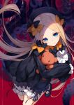 1girl abigail_williams_(fate/grand_order) bangs bison_cangshu black_bow black_headwear blonde_hair blue_eyes blush bow commentary_request dress eyebrows_visible_through_hair fate/grand_order fate_(series) forehead hair_bow hat highres long_hair long_sleeves looking_at_viewer object_hug orange_bow parted_bangs red_background sleeves_past_fingers sleeves_past_wrists smile solo stuffed_animal stuffed_toy teddy_bear tentacles very_long_hair