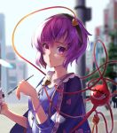 1girl adapted_costume bangs blouse blue_blouse blue_shawl bracelet city day expressionless eyebrows_visible_through_hair floral_print food hair_between_eyes head_tilt highres holding holding_food jewelry komeiji_satori looking_at_viewer outdoors parfait purple_hair rose_print short_hair solo third_eye touhou violet_eyes yaye
