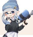 1girl bangs beanie black_shorts blue_headwear blunt_bangs blunt_ends brown_sweater clothes_writing collared_shirt commentary dolphin_shorts domino_mask fang grey_background grey_eyes grey_hair hat highres holding holding_weapon inkling letterboxed logo long_hair long_sleeves looking_at_viewer mask octoshot_(splatoon) open_mouth pointy_ears print_headwear shirt short_shorts shorts skin_fang smile solo splatoon_(series) splatoon_2 sweater symbol_commentary tentacle_hair v weapon white_shirt yuzutouhu_ika