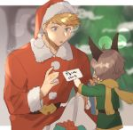1boy 1other artist_name bangs belt blonde_hair blurry blurry_background blush character_request christmas christmas_tree gift gift_bag granblue_fantasy green_eyes hat higashigunkan holding holding_paper light light_particles male_focus muscle paper santa_costume santa_hat shiny shiny_hair shirt solo vane_(granblue_fantasy)