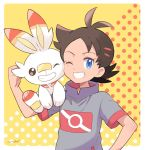 1boy black_hair blue_eyes dark_skin dark_skinned_male gen_8_pokemon gou_(pokemon) grin mei_(maysroom) one_eye_closed orange_background pokemon pokemon_(anime) pokemon_(creature) pokemon_swsh_(anime) polka_dot polka_dot_background scorbunny smile spiky_hair tagme