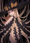 1girl abigail_williams_(fate/grand_order) absurdres ass bangs bao_(s_888) black_bow blonde_hair bow commentary_request dark_background fate/grand_order fate_(series) from_behind hair_bow hat hat_bow highres long_hair multiple_bows object_hug orange_bow parted_bangs polka_dot polka_dot_bow purple_bow red_eyes simple_background solo stuffed_animal stuffed_toy teddy_bear