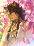 1boy animal_ear_fluff animal_ears bangs blurry braid brown_hair dark_skin dark_skinned_male day depth_of_field eyelashes flower green_eyes hair_between_eyes hair_fruit highres jewelry leona_kingscholar lion_ears long_hair looking_at_viewer male_focus mashuu_(neko_no_oyashiro) necklace parted_lips petals pink_flower side_braid smile solo spikes tassel twin_braids twisted_wonderland upper_body