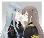 2girls armband bangs black_gloves black_jacket blunt_bangs blush border breasts brown_eyes brown_hair clenched_teeth clothes_writing commentary_request eye_contact eyebrows_visible_through_hair fingerless_gloves from_side girls_frontline gloves green_eyes grey_background hair_ornament hand_on_another's_chin highres hk416_(girls_frontline) jacket long_hair long_sleeves looking_at_another medium_breasts multiple_girls one_side_up outside_border parted_lips profile scar scar_across_eye sidelocks silver_hair simple_background smile sui_(camellia) teeth ump45_(girls_frontline) white_border yuri