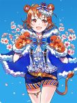 1girl ahoge animal_ears belt blouse blue_bow blue_cape blue_shorts bow cape cherry_blossoms claws crown double_bun eyebrows_visible_through_hair facing_viewer fluffy frills gloves hyugo lion_ears lion_tail love_live! love_live!_sunshine!! orange_belt orange_hair red_eyes ribbon short_hair shorts signature simple_background solo star_(symbol) striped striped_shorts tail takami_chika thigh_strap white_blouse