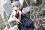 1other 2girls :> alternate_costume ari_don bare_arms blue_skirt blurry blurry_background braid carpet clothes_writing collarbone commentary_request contemporary dragon_tail dress dutch_angle feathered_wings french_braid from_above ghostbusters hakurei_reimu holding holding_sign kicchou_yachie kishin_sagume looking_at_viewer looking_back manga_(object) multiple_girls navy_blue_dress out_of_frame print_dress red_eyes short_hair sign silver_hair single_wing skirt sleeveless sleeveless_dress smile solo_focus standing suitcase table tail touhou wings