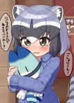 1girl alternate_costume animal_ears blue_hair blue_pajamas blue_shirt blush brown_eyes character_doll collared_shirt commentary_request common_raccoon_(kemono_friends) doll eyebrows_visible_through_hair fang flannel grey_hair highres holding holding_doll kemono_friends long_sleeves lucky_beast_(kemono_friends) multicolored_hair ngetyan pajamas raccoon_ears raccoon_girl raccoon_tail shirt short_hair solo tail tearing_up translation_request wavy_mouth