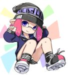 1girl arms_up black_footwear black_headwear black_shirt black_shorts domino_mask fang full_body hat inkling karukan_(monjya) mask pink_hair pointy_ears school_uniform serafuku shirt shoes short_hair short_shorts shorts sitting sleeves_past_wrists smile sneakers socks solo splatoon_(series) tentacle_hair violet_eyes