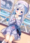 1girl :o bag bag_charm bangs beret blue_hair blue_jacket blue_skirt blurry blurry_background blush bow charm_(object) chinomaron collared_shirt commentary_request depth_of_field dutch_angle eyebrows_visible_through_hair ferris_wheel_interior frilled_legwear gochuumon_wa_usagi_desu_ka? hair_ornament hands_up hat hat_bow highres jacket kafuu_chino kneehighs long_hair long_sleeves looking_at_viewer open_clothes open_jacket parted_lips purple_headwear shirt shoulder_bag sitting skirt sleeves_past_wrists solo stuffed_animal stuffed_bunny stuffed_toy very_long_hair white_bow white_legwear white_shirt x_hair_ornament