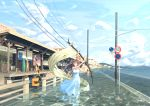 1girl artist_name brown_hair day dress flag highres holding holding_flag looking_at_viewer original outdoors power_lines reflection road_sign sandals scenery sena_(illust_sena) sign summer sundress train_station wading white_flag
