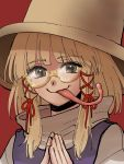 1girl bangs bespectacled blonde_hair closed_mouth eyebrows_visible_through_hair glasses hair_ribbon hands_clasped hands_together hat highres kuya_(hey36253625) long_tongue looking_at_viewer moriya_suwako own_hands_together purple_vest red_background red_ribbon ribbon round_eyewear semi-rimless_eyewear shirt short_hair simple_background smile solo tongue tongue_out touhou turtleneck upper_body vest white_shirt yellow-framed_eyewear yellow_eyes
