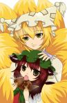2girls animal_ears averted_eyes blonde_hair brown_eyes brown_hair cat_ears cat_tail chen earrings eating fang food fox_tail hand_on_another's_head hat hat_with_ears jewelry light_smile looking_at_viewer mob_cap multiple_girls multiple_tails open_mouth short_hair tail taiyaki tassel touhou wagashi yakumo_ran yellow_eyes yuichi_(kaitsuki)