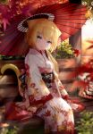 1girl absurdres animal_ears autumn_leaves bangs blonde_hair blue_eyes blurry blurry_foreground cat_ears cat_girl cat_tail depth_of_field floral_print fox_girl furisode guo582 hair_ornament hairclip hanazono_serena hanazono_serena_(channel) hand_on_lap highres japanese_clothes kimono leaf looking_at_viewer maple_leaf obi oriental_umbrella outdoors print_kimono red_umbrella sash sitting solo tail umbrella virtual_youtuber