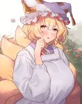 1girl adapted_costume animal_ears bangs blonde_hair blush bush commentary_request dress eyebrows_visible_through_hair fox_ears fox_tail frilled_hat frills hair_between_eyes hand_up hat heart highres kitsune long_sleeves looking_to_the_side masanaga_(tsukasa) multiple_tails open_mouth pillow_hat short_hair sidelocks sideways_glance solo speech_bubble tail tassel touhou upper_body white_dress white_robe yakumo_ran yellow_eyes
