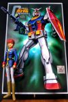 1boy amuro_ray beam_rifle brown_hair clenched_hands cody_(jkglfkfkxfi9ttg) copyright_name energy_gun figure gun gundam gunpla highres holding holding_gun holding_shield holding_weapon logo looking_to_the_side mecha mobile_suit_gundam model_kit photo rx-78-2 shield v-fin weapon