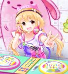 1girl :d absurdres animal_hat armpit_peek bangs blonde_hair blurry blurry_background blush breasts brown_eyes cat_hat collarbone commentary_request dj eva_16-gouki eyebrows_visible_through_hair futaba_anzu graffiti hair_between_eyes hair_bobbles hair_ornament hairclip hat headphones headphones_around_neck highres idolmaster idolmaster_cinderella_girls idolmaster_cinderella_girls_starlight_stage long_hair looking_at_viewer low_twintails open_mouth overall_shorts phonograph pink_headwear scrunchie shirt short_sleeves sidelocks small_breasts smile smug solo standing t-shirt turntable twintails upper_body v wall white_shirt wrist_scrunchie wristband x_hair_ornament