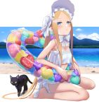 1girl abigail_williams_(fate/grand_order) abigail_williams_(swimsuit_foreigner)_(fate) bangs bare_shoulders beach bikini black_cat blonde_hair blue_eyes blue_sky blush bonnet bow breasts cat fate/grand_order fate_(series) forehead highres illyasviel_von_einzbern_(swimsuit_archer)_(fate) innertube legs long_hair looking_at_viewer multiple_bows open_mouth parted_bangs shore sidelocks sitting sky small_breasts swimsuit tsuchifumazu twintails very_long_hair wariza white_bikini white_bow white_headwear