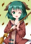 1girl animal_ears blush broom brown_dress commentary_request dress falling_leaves fang gradient gradient_background green_background green_eyes green_hair highres holding holding_broom kasodani_kyouko leaf long_sleeves looking_at_viewer medium_hair one_eye_closed open_mouth ruu_(tksymkw) smile solo touhou upper_body