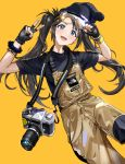 1girl :d absurdres arm_up bangs beanie black_gloves black_hair black_headwear black_shirt blue_eyes blush brown_background camera camera_around_neck commentary_request eyewear_on_head fingerless_gloves gloves goggles hand_up hat highres idolmaster idolmaster_shiny_colors lifted_by_self long_hair mitsumine_yuika open_mouth overalls shirt short_sleeves simple_background smile solo ssamjang_(misosan) supreme the_north_face twintails v very_long_hair