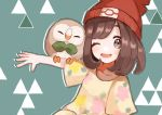 1girl bangs beanie brown_hair collarbone commentary_request floral_print gen_7_pokemon green_background grey_eyes hat highres medium_hair one_eye_closed open_mouth pokemon pokemon_(creature) pokemon_(game) pokemon_on_arm pokemon_sm red_headwear rowlet sarasouzyu0705 selene_(pokemon) shirt short_sleeves smile t-shirt tongue yellow_shirt