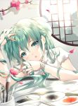 1girl arm_up blush commentary_request day flower flower_bracelet green_eyes green_hair hand_up hatsune_miku highres indoors long_hair looking_at_viewer paintbrush parted_lips petals red_flower rhea_(0u0) round_window shirt short_sleeves solo sunlight tree_branch upper_body vocaloid white_flower white_shirt window