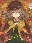 1girl aizawa85 autumn autumn_leaves bangs beret blush book brown-framed_eyewear brown_eyes brown_hair brown_headwear brown_jacket closed_mouth commentary_request dress eyebrows_visible_through_hair fringe_trim ginkgo_leaf glasses green_dress hair_between_eyes hat holding holding_book jacket leaf long_hair long_sleeves looking_at_viewer lying maple_leaf mouth_hold on_back open_book open_clothes open_jacket original shawl sleeves_past_wrists smile solo
