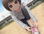 1girl brown_eyes brown_hair commentary day dutch_angle hood hoodie looking_at_viewer one_knee original outdoors pun shoelaces shoes short_hair smile solo tying_shoes yajirushi_(chanoma)