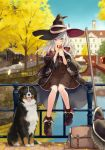 1girl azuuru bag blue_eyes bridge broom building day dog eating elaina_(majo_no_tabitabi) eyebrows_visible_through_hair food hair_between_eyes hat highres holding holding_food licking_lips long_hair looking_at_viewer majo_no_tabitabi outdoors railing shoes sitting_on_railing sky solo tongue tongue_out tree water white_hair witch_hat