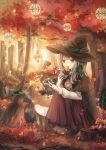 1girl absurdres animal autumn autumn_leaves blush_stickers broom cape commentary day deer eating fantasy food forest hat highres huge_filesize lantern magic mushroom nature original outdoors pink_eyes silver_hair sitting sweeping sweet_potato tukimisou0225 witch witch_hat yakiimo