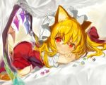 1girl animal_ears beads bed blonde_hair blush bow cat_ears closed_mouth commentary_request crossed_arms crystal dress dutch_angle eyebrows_visible_through_hair flandre_scarlet fuupu hair_between_eyes hair_bow hat head_rest highres kemonomimi_mode long_hair looking_to_the_side lying mob_cap on_stomach puffy_short_sleeves puffy_sleeves red_bow red_dress red_eyes short_sleeves smile solo top-down_bottom-up touhou wings