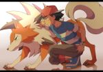 1boy ash_ketchum backwards_hat baseball_cap black_hair blue_footwear blush brown_eyes capri_pants closed_mouth commentary_request cyaneko gen_7_pokemon hat lycanroc lycanroc_(midday) pants pokemon pokemon_(anime) pokemon_sm_(anime) shirt shoes short_sleeves smile squatting striped striped_shirt t-shirt z-ring
