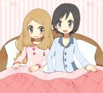1boy 1girl ako_(ako0905) bed black_hair blush buttons calem_(pokemon) collarbone commentary_request eyebrows_visible_through_hair eyelashes eyes_visible_through_hair holding indoors light_brown_hair long_hair long_sleeves looking_at_another open_mouth pajamas pillow pokemon pokemon_(game) pokemon_xy serena_(pokemon) smile teeth tongue under_covers