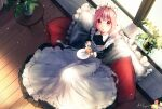 1girl amamami_prime apron blush braid breasts cup dress from_above hair_between_eyes highres indoors long_dress looking_at_viewer maid maid_apron maid_dress maid_headdress medium_breasts medium_hair multicolored multicolored_eyes open_mouth original pillow pink_eyes pink_hair plant red_eyes short_twintails single_braid sitting solo tea teacup twintails window