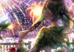 1girl alternate_costume backlighting bangs blurry_foreground blush brown_hair cluseller commentary_request eyebrows_visible_through_hair fan fence fireworks floral_print flower from_behind green_eyes green_kimono green_ribbon hair_ribbon half-closed_eyes hand_up happy hinamizawa_kurumi holding japanese_clothes kimono long_hair long_sleeves looking_at_viewer looking_back mole mole_under_eye open_mouth outdoors paper_fan pouch pygmalion._(group) ribbon shiny shiny_hair side_ponytail smile solo standing swept_bangs teeth tied_hair tongue uchiwa upper_body virtual_youtuber white_flower