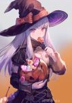 1girl artist_name azutarou black_headwear blush bow buttons candy commentary_request epaulettes eyebrows_visible_through_hair fire_emblem fire_emblem:_three_houses floating_hair food garreg_mach_monastery_uniform hair_between_eyes halloween hat holding holding_candy holding_food jack-o'-lantern licking lollipop long_hair looking_at_viewer lysithea_von_ordelia orange_bow orange_ribbon pink_eyes ribbon solo twitter_username uniform white_hair witch witch_hat