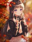 1girl autumn autumn_leaves bangs black_shirt blunt_bangs blurry blurry_foreground blush brown_hair camera cardcaptor_sakura closed_mouth commentary_request daidouji_tomoyo depth_of_field eyebrows_visible_through_hair falling_leaves floating_hair hands_up heeri holding holding_camera leaf long_hair long_sleeves looking_at_viewer maple_leaf neckerchief outdoors pleated_skirt sailor_collar shirt skirt smile solo violet_eyes white_headwear