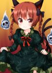 1girl animal_ears bangs black_bow black_tail bow braid cat_ears cat_tail closed_mouth dress eyebrows_visible_through_hair frilled_dress frills gradient gradient_background green_dress hair_bow highres hitodama holding holding_clothes holding_dress kaenbyou_rin long_sleeves looking_at_viewer medium_hair multiple_tails orange_eyes orange_hair red_neckwear red_ribbon ribbon ruu_(tksymkw) skull smile tail touhou twin_braids two_tails