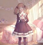 1girl bangs bed black_legwear blonde_hair bottle clip dappled_sunlight frilled_skirt frilled_sleeves frills green_eyes knife knife_behind_back looking_at_viewer medium_skirt original pantyhose photo_(object) pillow pink_ribbon red_ribbon ribbon shelf skirt smile solo string sunlight twintails yoshicha
