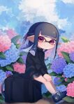 1girl akr_tmr bangs black_hair black_shorts black_sweater blue_flower blue_footwear blunt_bangs blunt_ends closed_mouth day dolphin_shorts domino_mask flower from_side half_updo highres inkling long_hair long_sleeves looking_at_viewer mask no_socks outdoors pink_flower pointy_ears shoes short_shorts shorts sitting sloshing_machine_(splatoon) smile sneakers solo splatoon_(series) splatoon_2 sweater tentacle_hair violet_eyes