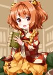 1girl apron bangs bell book brown_background character_name checkered checkered_kimono clothes_writing eyebrows_visible_through_hair green_skirt hair_bell hair_ornament highres holding holding_book japanese_clothes jingle_bell kimono long_sleeves looking_at_viewer medium_hair motoori_kosuzu open_mouth orange_hair red_eyes romaji_text ruu_(tksymkw) skirt smile solo standing touhou twintails two_side_up wide_sleeves yellow_apron