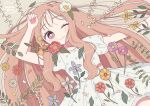 1girl :3 artist_name bracelet bright_pupils closed_mouth dress floral_print flower from_above hair_flower hair_ornament highres jewelry leaf long_hair lying nokanok on_back one_eye_closed orange_flower original outstretched_arm petals pink_eyes print_dress puffy_short_sleeves puffy_sleeves purple_flower red_flower short_sleeves sidelocks solo symbol_commentary very_long_hair white_flower white_pupils yellow_flower